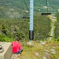 A hike takes in the view and sunshine from under one of Sugarbush's chairlifts.- Mount Ellen via the Long Trail