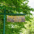 Roadside sign marks the trailhead.- Belfry Mountain Fire Tower