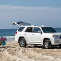 A woman reading a book in the over-sand vehicle zone.- Assateague Island National Seashore