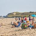 People sunbathing.- Cape Henlopen State Park