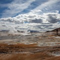 Gorgeous cloudscape looking over mud pots.- Namaskard / Namafjall