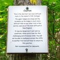 Sign warning hikers of the trail's difficulty.- Mount Cardigan via the Holt Trail Loop