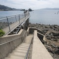 A stairway built by the Oregon Department of Fish and Wildlife that leads down to the Tillamook Bay clam flats.- Pier's End Historic Coast Guard Boathouse