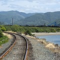 View of the Oregon Coast Scenic Railroad in Garibaldi with the Whitney Smokestack in the distance.- Oregon Coast Scenic Railroad