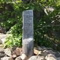 A trail marker appears halfway through to direct you to the summit of Champlain.- The Precipice Trail