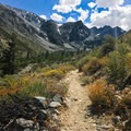 The trail starts off at 7,800 feet, curving through fragrant shrubs as it hugs Big Pine Creek.- Finger Lake via Big Pine Creek South Fork Trail