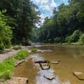Base of the Blackburn Fork River Trail.- Cummins Falls State Park Waterfall