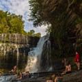 Visitors enjoying the falls.- Cummins Falls State Park Waterfall