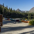 Two Medicine Lake boat dock and trailhead.- Aster Park Overlook Hike