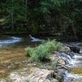 The first drop into Cummins Falls.- Cummins Falls State Park Hike