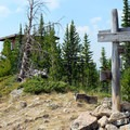 The signpost and fire lookout on top of the ridge.- Cinnamon Mountain Lookout