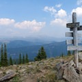 View of the wooden post in front of the Gallatin Range.- Cinnamon Mountain Lookout