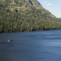 The Sinopah traversing the lake.- Two Medicine Lake Loop Hike
