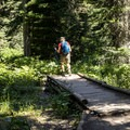 From the boat dock, the trail heads up toward Dawson Pass.- No Name Lake Hike