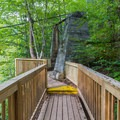 A wooden catwalk along the trail to Burgess Falls.- Burgess Falls State Park Waterfall