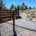 A signed fork marks where the Cave Loop path splits from the Mushpot Cave Trail.- Cave Loop