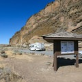 An informational kiosk marks the parking area beside the petroglyphs.- Petroglyph Point and Petroglyph Bluff Hike