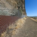 Due to vandalism, visitors must view the pictographs from behind a chain-link fence.- Petroglyph Point and Petroglyph Bluff Hike