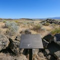 A sign marks the end of the hiking path atop the bluff.- Petroglyph Point and Petroglyph Bluff Hike