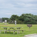 All sites have picnic tables and small grills.- Ocracoke Campground