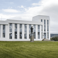 Vigeland's Statue of Snorri and the rectory.- Reykholt