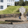 Snorri's Pool and restored tunnel.- Reykholt