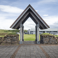 Archway to the grounds and the Fosshótel.- Reykholt