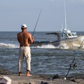 A fisherman on the inlet jetty.- Ocean City