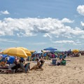 Sunbathers under their umbrellas on the beach.- Ocean City