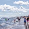 People walking along the coast. - Ocean City