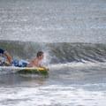 A boogie boarder riding waves.- Assateague Island National Seashore