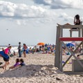 Crowds watching large waves caused by a storm offshore.- Assateague Island National Seashore