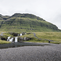 The path leads along the bank of the river.- Kirkjufell and Kirkjufellsfoss