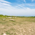 An open field at Gay Head Lighthouse with stones marking its previous location.- Gay Head Lighthouse