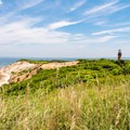 Aquinnah Cliffs and the Gay Head Lighthouse lookout point.- Gay Head Lighthouse