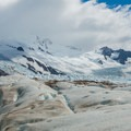 Rio Tunel Glaciar Inferior continues up thousands of feet to mountain peaks.- Huemul Circuit
