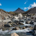 Stream crossing with part of Cerro Huemul looming.- Huemul Circuit