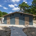 The centrally-located bath houses and lavatories.- Cape Henlopen State Park Campground