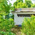 One of the bunkers hidden among the trees.- Odiorne Point State Park + Seacoast Science Center