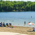 The beach at Thompson's Lake.- Thompson's Lake Campground
