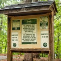 Signs help to navigate through the many sites.- Devils Fork State Park Campground