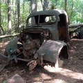 Abandoned truck in a clearing along the Bull Mountain Trail.- Jake and Bull Mountain Trail Network
