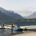 Boat dock on Lake McDonald.- Lake McDonald Lodge