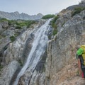 Staying right on the leftmost waterfall.- Mount Goode: Northeast Buttress