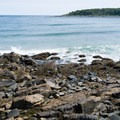 The rocky beach at the beginning of the cliff walk.- Cliff Walk