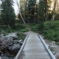 A developed bridge crossing over a river in Lower Paintbrush Canyon.- Paintbrush Canyon to Cascade Canyon Loop
