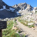 A sign marks the beginning of the Upper Paintbrush Camping Area. Look for more signs pointing out campsites.- Paintbrush Canyon to Cascade Canyon Loop