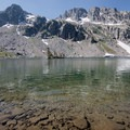 Lake Solitude offers crystal clear waters to take a dip in before completing the second half of your hike.- Paintbrush Canyon to Cascade Canyon Loop