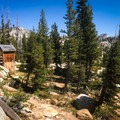 You'll know you've reached the High Sierra Camp when you pass a wooden building with vault toilets.- Sunrise Lakes