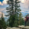 After the parking area and a traverse through the forest, the trail ascends switchbacks with a striking view.- Sunrise Lakes